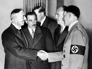 Adolph Hitler chats with Neville Chamberlain