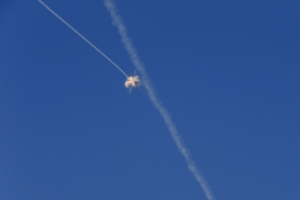 An interception of a rocket by the Iron Dome anti-missile system is seen above the Israeli town of Sderot July 21, 2014. Photo credit Baz Ratner/Reuters