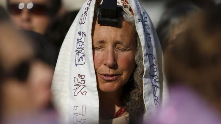 "A member of ""Women of the Wall"" group wears a Jewish prayer shawl and Tefillin a monthly prayer session at the Western Wall in Jerusalem's Old City. May 10, 2013 Credit: Reuters"