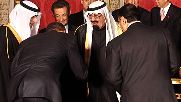 President Barack Obama bowing to then Saudi King Abdullah in 2009