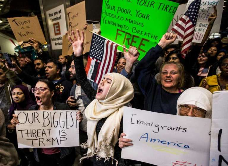 Demonstrators protest against President Donald Trump's executive orders on immigration at George Bush Intercontinental Airport on Sunday, Jan. 29, 2017, in Houston. (Photo by Brett Coomer, Houston Chronicle)