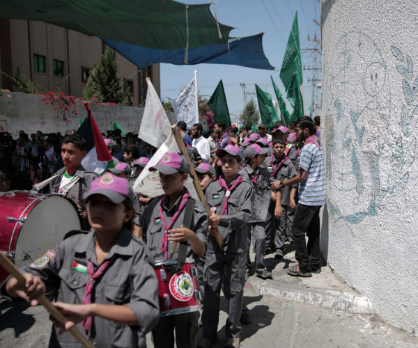 Palestinian children who support Hamas, march in 2015 as they demonstrate against the U.N. relief. (Khalil Hamra/AP)