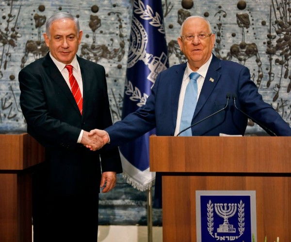 Israeli President Reuven Rivlin (R) tasks Prime Minister Benjamin Netanyahu with forming a new government, during a press conference in Jerusalem on September 25, 2019. (Menahem Kahana/AFP/Getty Images)